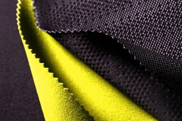 Perforated black and volt green Ariaprene material