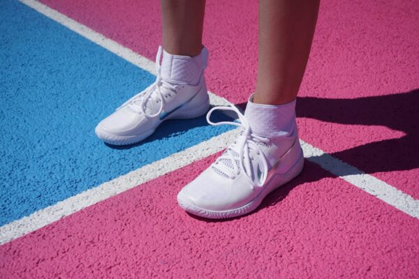 White sneakers on a tennis court