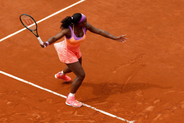 Serena Williams playing tennis on a clay court